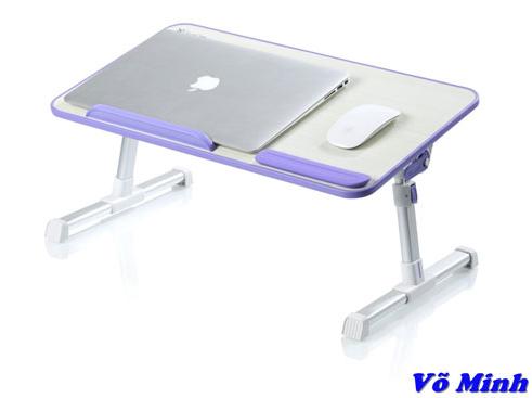 ban_laptop_tren_giuong